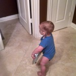 Toddler Running around with Bathroom Scale