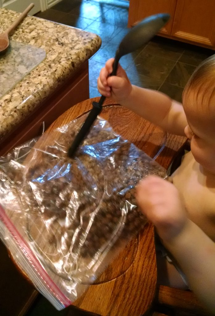 Crushing up Cocoa Puffs cereal